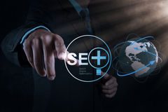 Businessman hand showing search engine optimization Stock Photo