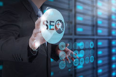 Businessman hand showing search engine optimization SEO Royalty Free Stock Images