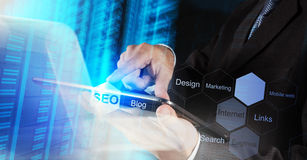 Businessman hand showing search engine optimization Stock Photos