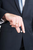 Businessman hand showing small size Royalty Free Stock Photography