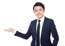 Businessman with hand showing something Stock Photos