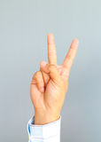 Businessman'hand showing two fingers. On gray background, Ready to fight concept Royalty Free Stock Photography