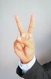 Businessman'hand showing two fingers. On gray background, Ready to fight concept Royalty Free Stock Photos