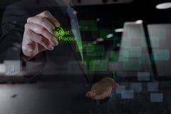Businessman hand shows best practice word Stock Photos