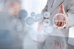 Businessman hand shows gear business success chart Stock Photos