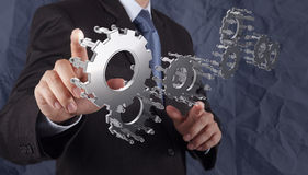 Businessman Hand Shows Gear To Success Concept Stock Photos