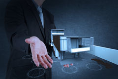 Businessman hand shows house model Stock Photo