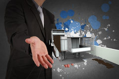 Businessman hand shows house model Royalty Free Stock Photography