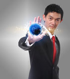 Businessman hand shows icon transportation on the world. Stock Photography