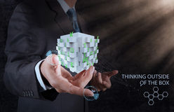 Businessman hand shows word thinking outside the box royalty free stock photos