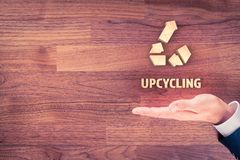 Upcycling concept. Businessman with hand, symbol of upcycling and text upcycling royalty free stock image