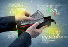 Businessman hand takes out dollar from wallet Stock Images