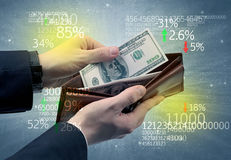 Businessman hand takes out dollar from wallet Stock Photography