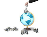Businessman hand taking money symbols on terrestrial globe Royalty Free Stock Image