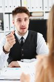 Businessman hand threatens his hired employees. Threatens staff with dismissal looking for guilty accuses no fulfillment of tasks and delay in action plan at Royalty Free Stock Photography