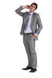 Businessman with hand to ear Royalty Free Stock Photo