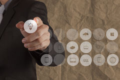 Businessman hand touch graphic icon light bulb Stock Image