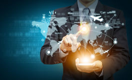 Businessman hand touch location on world map with network Stock Images