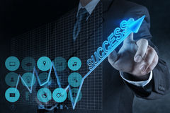 Businessman hand touch virtual success chart Royalty Free Stock Images