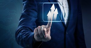 Businessman hand touches purposeful white arrows. Royalty Free Stock Photo