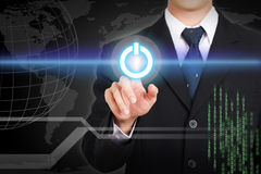 Businessman hand touching  power concept on screen. Stock Photo
