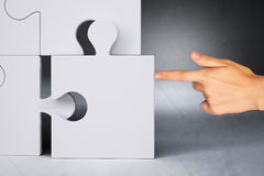 Businessman Hand Touching Puzzle Piece Stock Photo