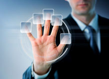 Businessman hand on a touchscreen Stock Photo