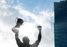 businessman hand with trophy shade with building and sky Royalty Free Stock Photos