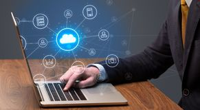 Hand typing with cloud technology system concept. Businessman hand typing with cloud technology system and office symbol conceptn stock photo