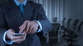 Businessman hand use smart phone computer with email icon as con. Cept Stock Photo