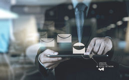 Businessman hand use smart phone computer with email icon as con. Double exposure of businessman hand use smart phone computer with email icon as concept Stock Photo