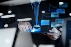 Businessman hand use smart phone computer with email icon Royalty Free Stock Image