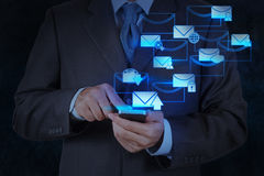 Businessman hand use smart phone computer with email icon Royalty Free Stock Images
