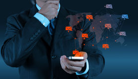 Businessman hand use smart phone computer with modern email royalty free stock image