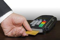 Businessman. Hand using credit card reader machine Royalty Free Stock Photos