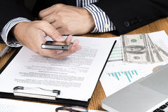 Businessman hand using smart phone. Stock Images