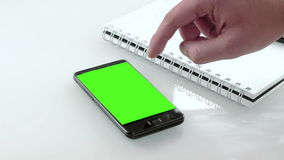 Businessman hand using a smart phone in the office with chroma key, green screen stock footage