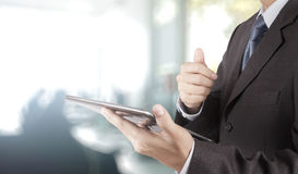 Businessman hand using tablet computer and office Royalty Free Stock Photo