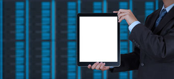 Businessman hand using tablet computer and server room backgroun Stock Image
