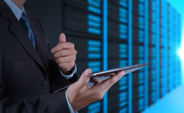 Businessman hand using tablet computer and server room Stock Photography