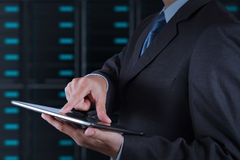 Businessman hand using tablet computer and server room Stock Photos