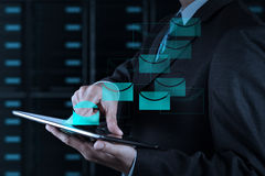 Businessman hand using tablet computer and server room Royalty Free Stock Photo