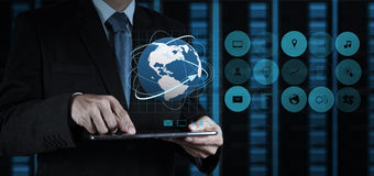 Businessman hand using tablet computer and server room. Background Royalty Free Stock Photo
