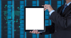 Businessman hand using tablet computer and server. Room background as concept stock photography