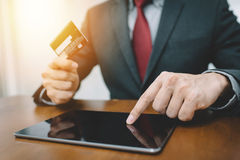 Businessman hand using tablet and credit card. For online shopping or banking. Fintech concept Royalty Free Stock Photography