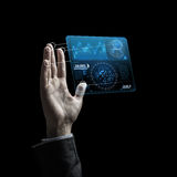 Businessman hand with virtual charts over black Royalty Free Stock Photos