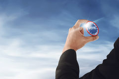 Businessman hand with a vote button. Election day background or concept Stock Photography