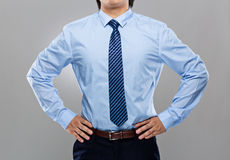 Businessman with hand on waist Stock Photos