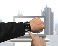 Businessman hand wearing black glass smartwatch with bent interf Royalty Free Stock Images