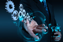 Businessman hand working with cog gear to success. As concept royalty free stock image